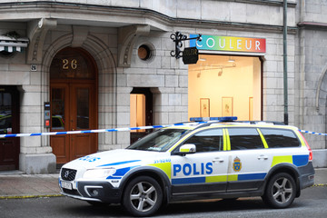 Police car is parked in front of an art gallery where Salvador Dali works have been stolen, in Stockholm
