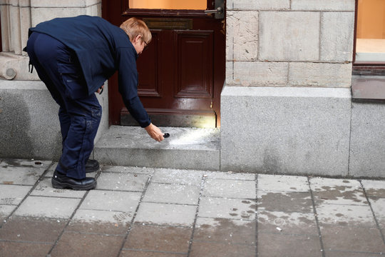 Police officer inspects the entrance of an art gallery where Salvador Dali works have been stolen, in Stockholm
