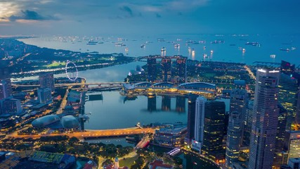 Fototapete - Hyperlapse or Dronelapse scene of Singapore business district downtown at sunrise