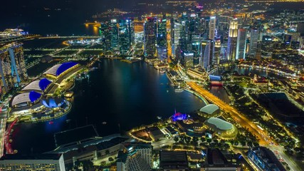 Fototapete - Hyperlapse or Dronelapse scene of Singapore business district downtown at night