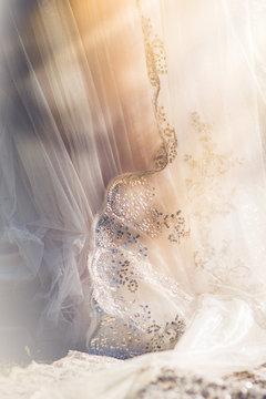 Sunlight filtering through a wedding dress