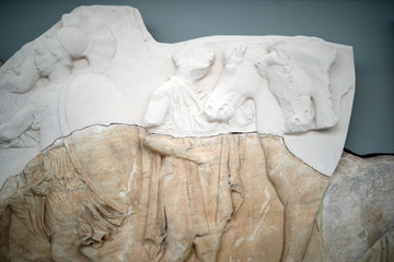 An original sculpture from the Parthenon frieze temple is seen partially reconstructed by plaster, at the Parthenon Gallery of the Acropolis Museum, in Athens
