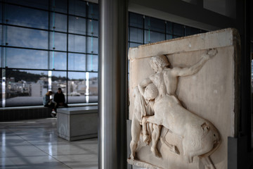 An original sculpture of the frieze of the Parthenon temple is exhibited at the Parthenon Gallery of the Acropolis Museum, in Athens