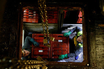 "Fishermen of French trawler ""Notre Dame de Boulogne"" unload crates of fish in the port of  Boulogne-sur-Mer"