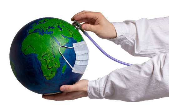 Concept of global problems of planet earth. Diseases, viruses, infections, epidemics. Air pollution of the environment. The doctor's hands with a phonendoscope treat the planet earth in a medical mask