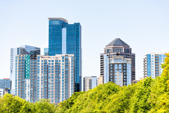 Atlanta, USA - April 20, 2018: Cityscape, skyline view in Piedmont Park in Georgia downtown, green trees, scenic urban city skyscrapers