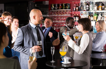Coworkers talking at office party