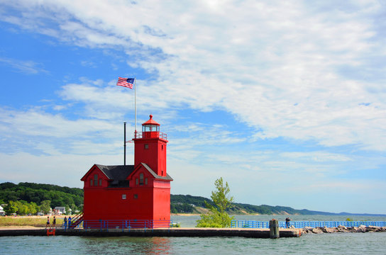 American Flag Flies Over the Holland Harbor Lighthouse