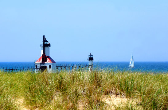 Boat travels Lake Michigan Besides St. Joseph Lighthouse