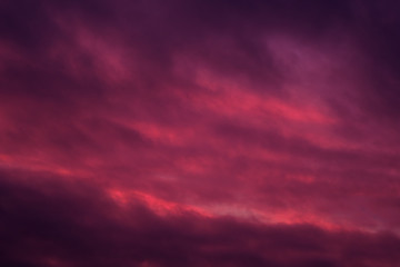 Background of sky pink red colours cloudscape, full frame nature landscape