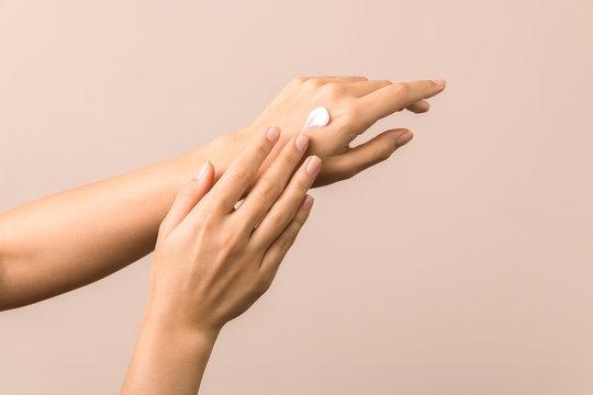 skincare. close up view of woman hand moisturising them with cream. skincare