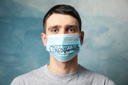 Boy in protective mask with inscription Coronavirus on blue background. Healthcare and medical concept