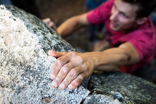 Close up of man climbing on rock