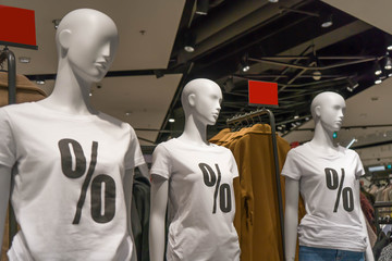 mannequins of girls with the inscription on white t-shirts discount sale percent