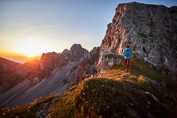 Mature man trail running on mountain ridge at Axame Lizum, Austria