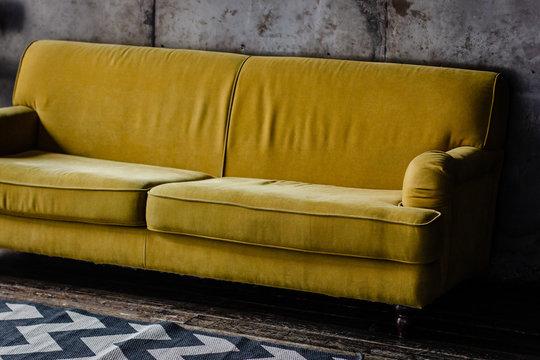 Yellow velvet couch in loft room