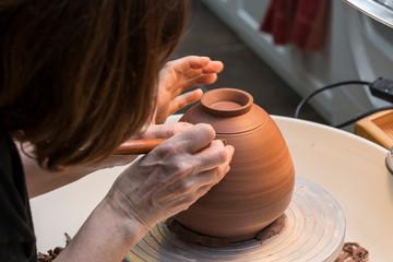 works with mud, creative craftsmen