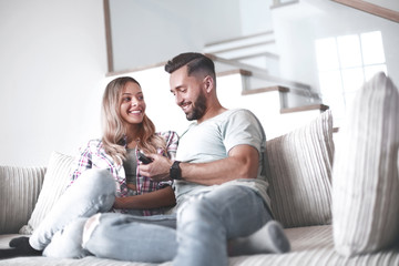 loving couple sitting on sofa in cozy living room
