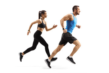 Fit man and woman in sportswear running