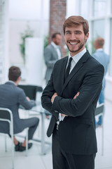 confident young businessman standing in the office