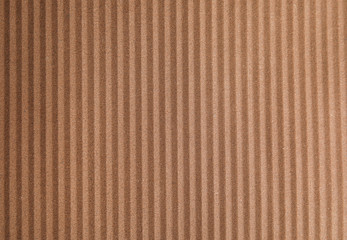 Brown corrugated sheet of cardboard as background, top view