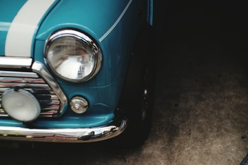 Wall Murals Vintage cars Close-Up Of Vintage Car Headlight And Chrome Bumper