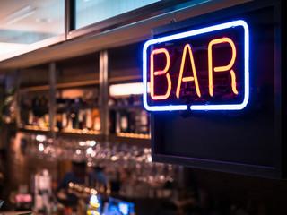 Bar signage Lights Neon sign Blur bar counter shelf glasses bottles Party background