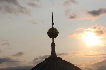 Fototapeta Spire Against Sky During Sunset