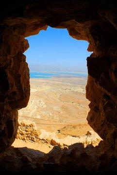 Scenic View Of Masada Seen Through Cave Window