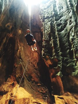 Young Man Exploring Cave