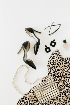 Modern fashion female clothes and accessories on white background. Flatlay, top view.