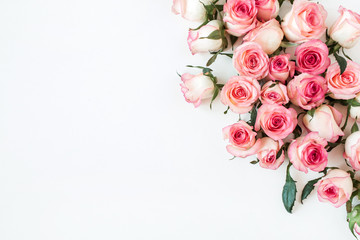 Keuken foto achterwand Roses Floral composition with pink rose flower buds on white background. Flat lay, top view.