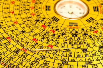 Acupuncture needle on chinese feng shui compass