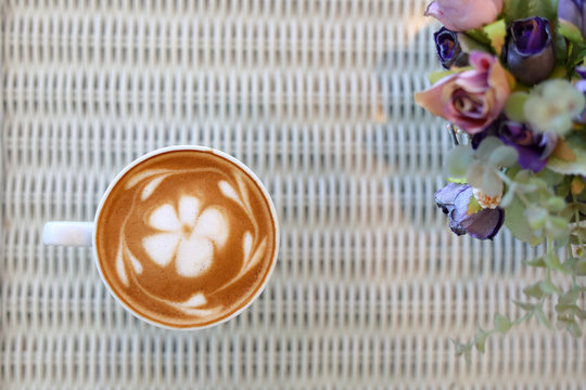 frangipani plumeria fragrant flower of latte art in hot coffee drink put on table in cafe restaurant