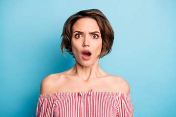 Closeup photo of crazy shocked lady open mouth listen unbelievable bad terrible news wear striped white red blouse open shoulders isolated blue color background