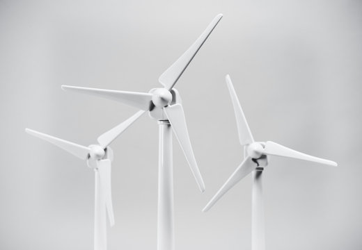 Three wind turbines on white background