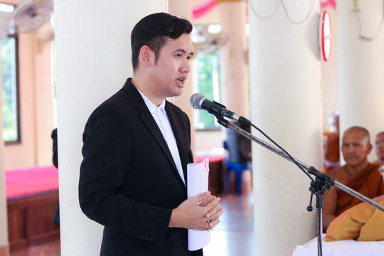 Side View Of Man Giving Speech On Microphone During Event