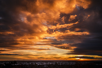 Photo sur Toile Marron chocolat Dramatic orange sunset on the Grand Canyon after a storm