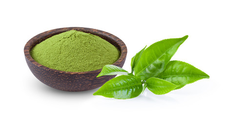 powdered matcha green tea in bowl with leaf  isolated on white