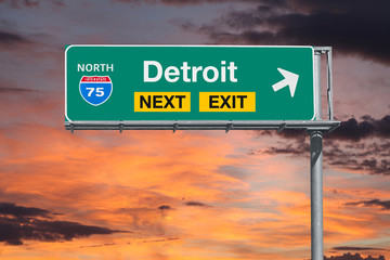 Detroit Michigan route 75 freeway exit sign with sunset sky.