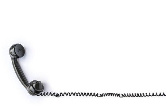Telefonhörer eines alten Telefons freigestellt vor weißem Hintergrund als Vorlage für Weiterbearbeitung