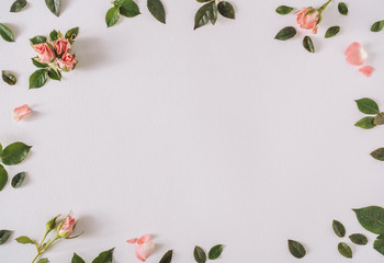 Rose pastel pink flowers and leaves. Spring or summer frame background. Flat lay social mockup with copy space.