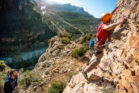 Side View Of Mid Adult Man Climbing Mountain During Sunny Day