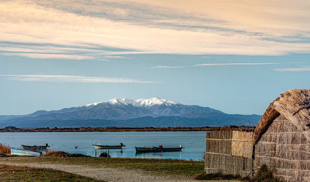 Historic fishing village and the Etang de Canet lagoon and Canigou in the background