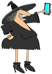 Halloween witch taking a selfy on her phone