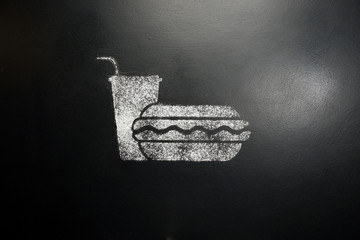 Hot dog and drink. Drawing on a black chalkboard