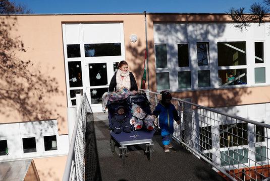 Lutheran pastor Boglarka Gyori, 31, leaves the the kindergarten with her children, in Kaposvar