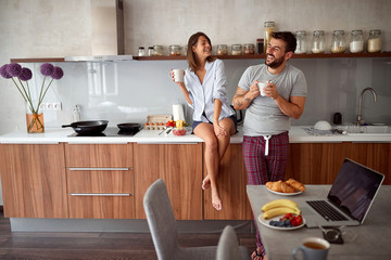 happy man and woman in morning drinking coffee together. Love, Romance and valentine's day concept.