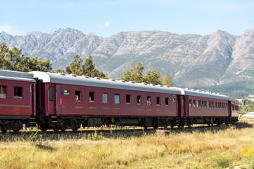 Wolseley, Swartland region, South Africa. Dec 2019. Steam train excursion passing through the Swartland region with a mountain backdrop.