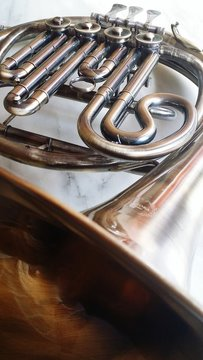Low Angle View Of French Horn Against Wall